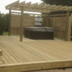 deck with hot-tub and pergola